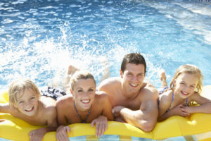 Family in the pool - inground pool companies San Diego
